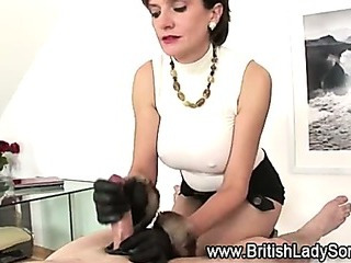 Booted british slut handjob