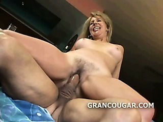 Blonde granny riding cock as she moans with pleasure